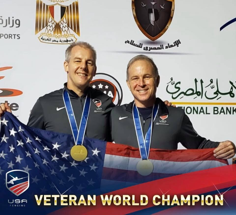 Mark Lunborg and Joshua Runyan show off their GOLD medals