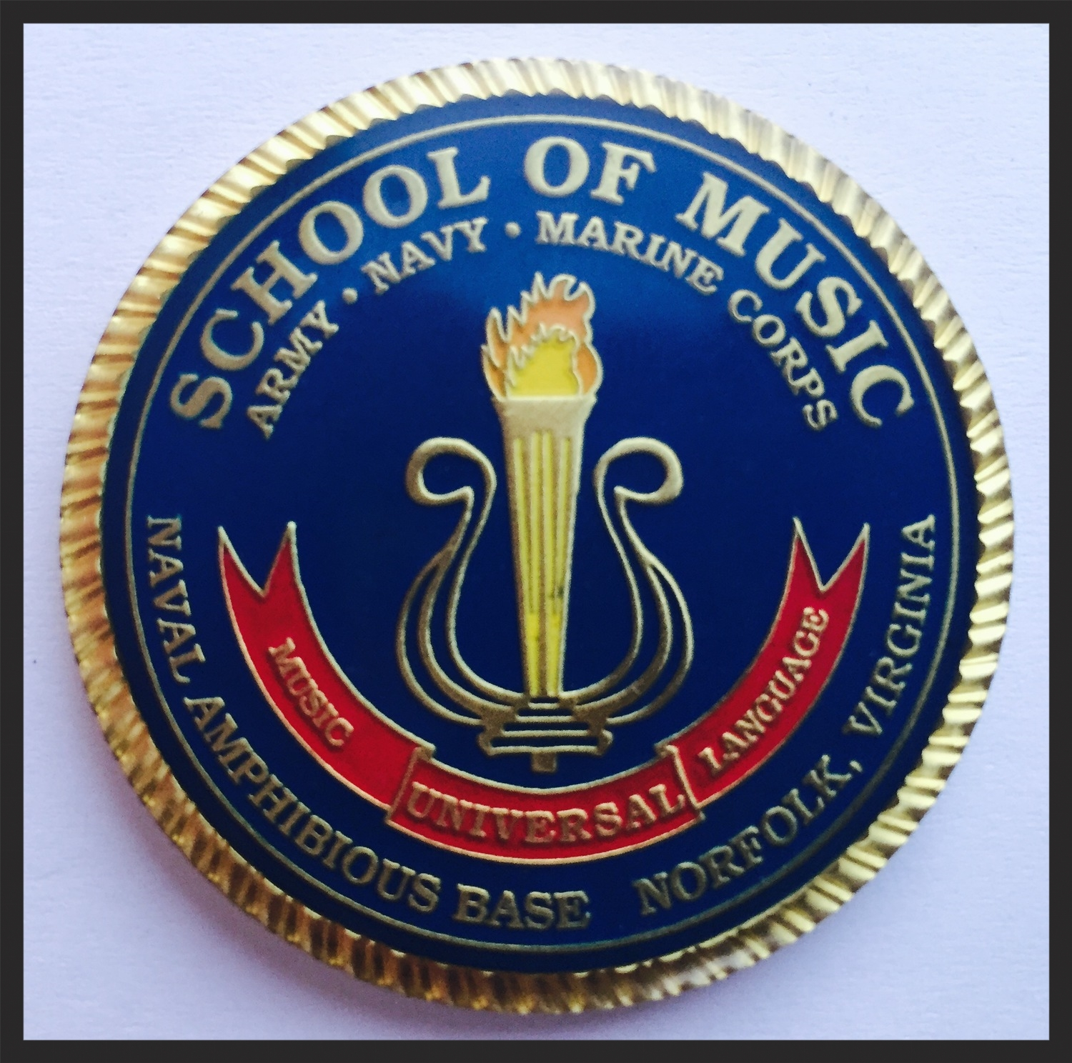 Students who graduate the Navy School of Music with a score of 3.0 or higher get the honor of a name plaque on the walls of the school, as well as a command coin.
