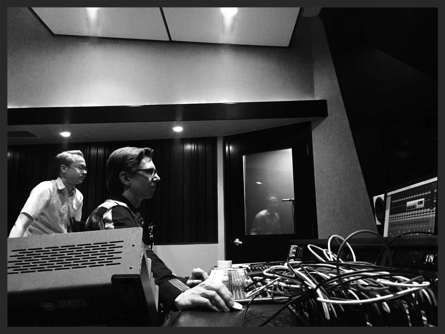 G Burns Jug Band's Clint Davis and engineer Chris Hobson intently listening back to another keeperat Rarefied.