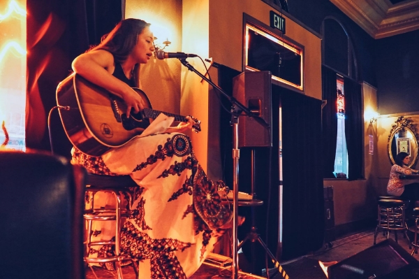 Artist Celeste Byers, known to many for her murals all around the world, shared her exceptional singing and guitar talents at the Black Cat Bar acoustic evening. Photo: Nick Lane