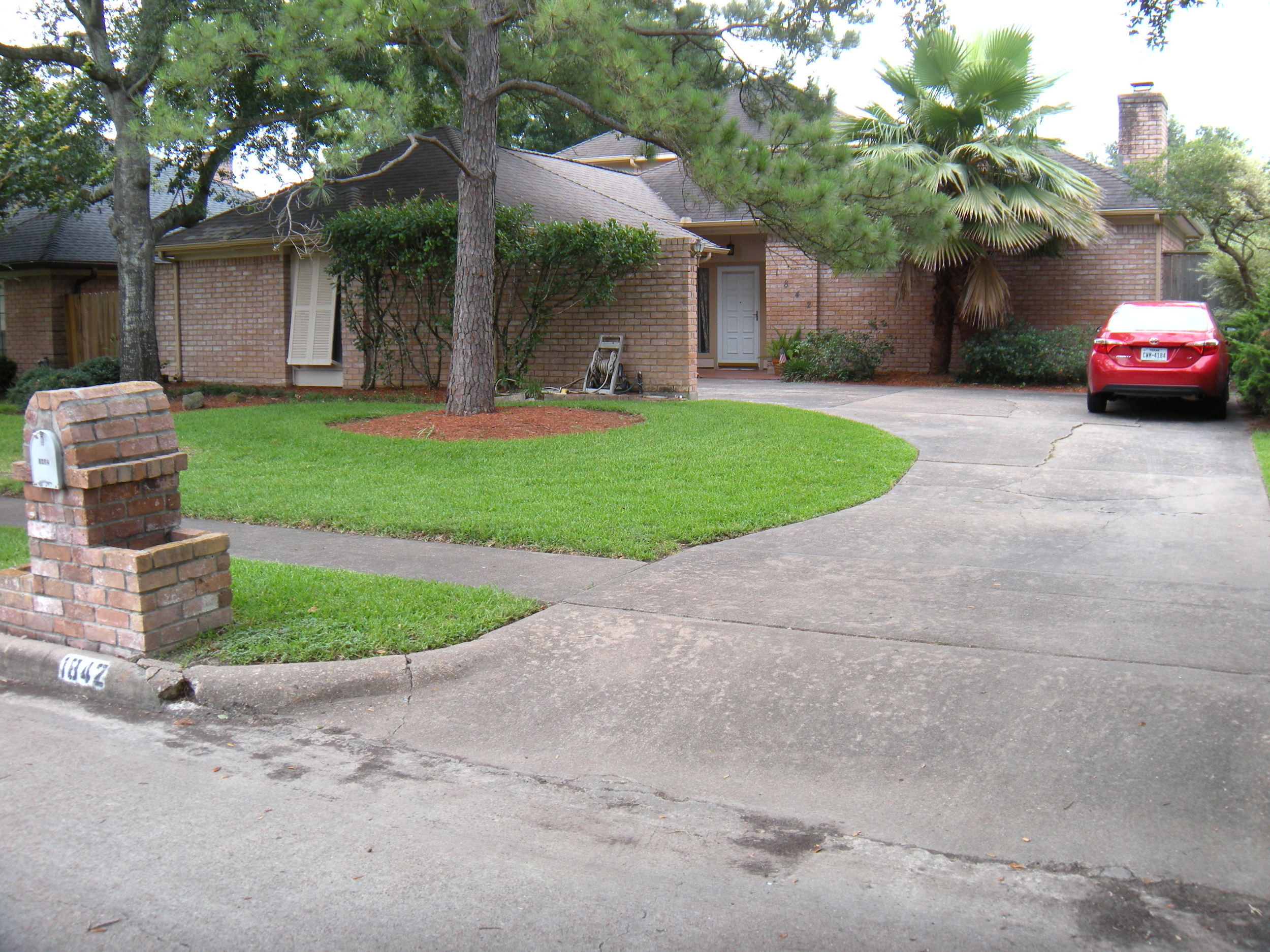 Trina's house. The corolla in the driveway is my rental car. The curb doesn't look like it's at prohibitive, but it obviously is. I've clunked over it every time I've reversed out of there.