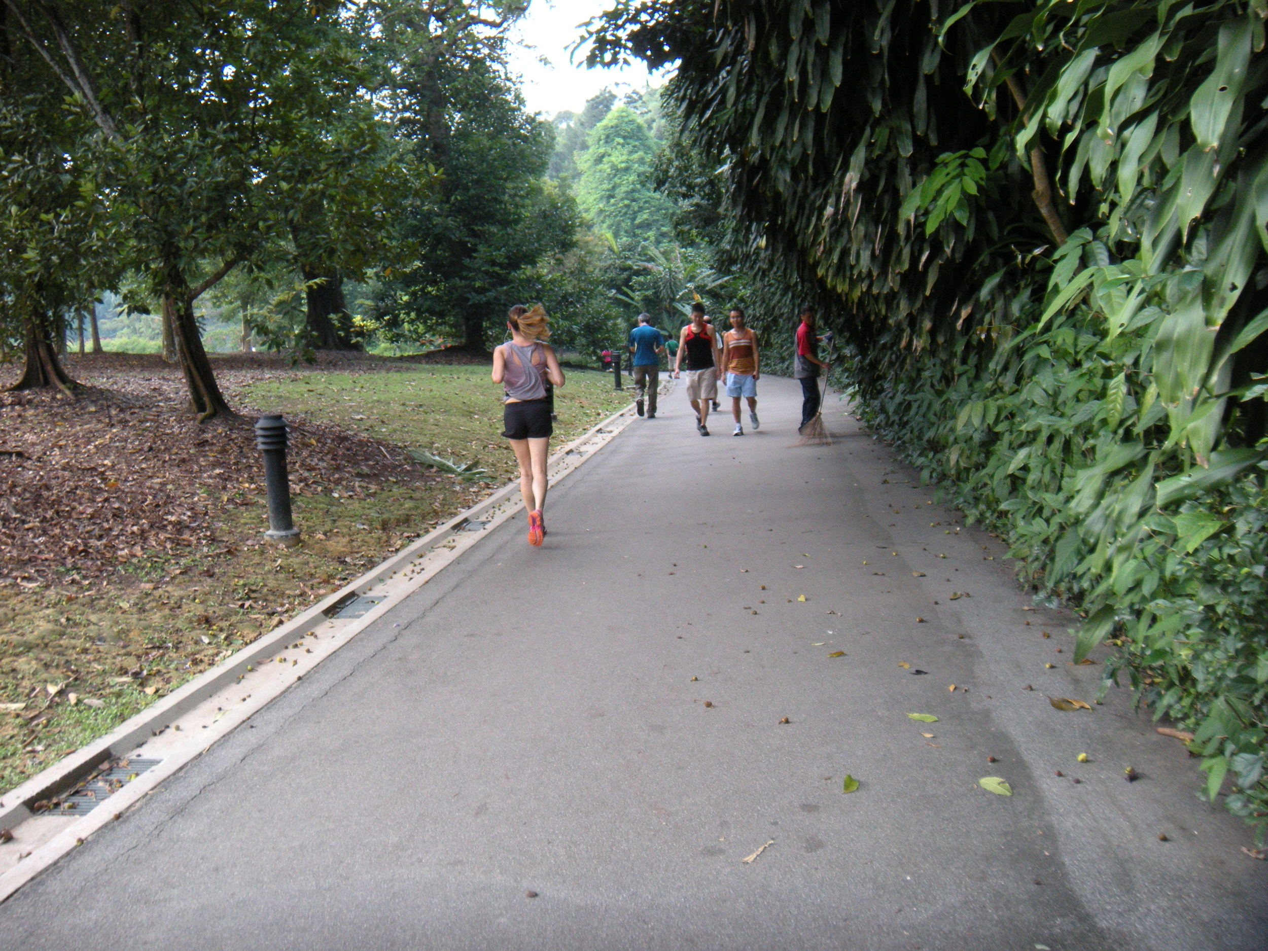 The woman running in the park.