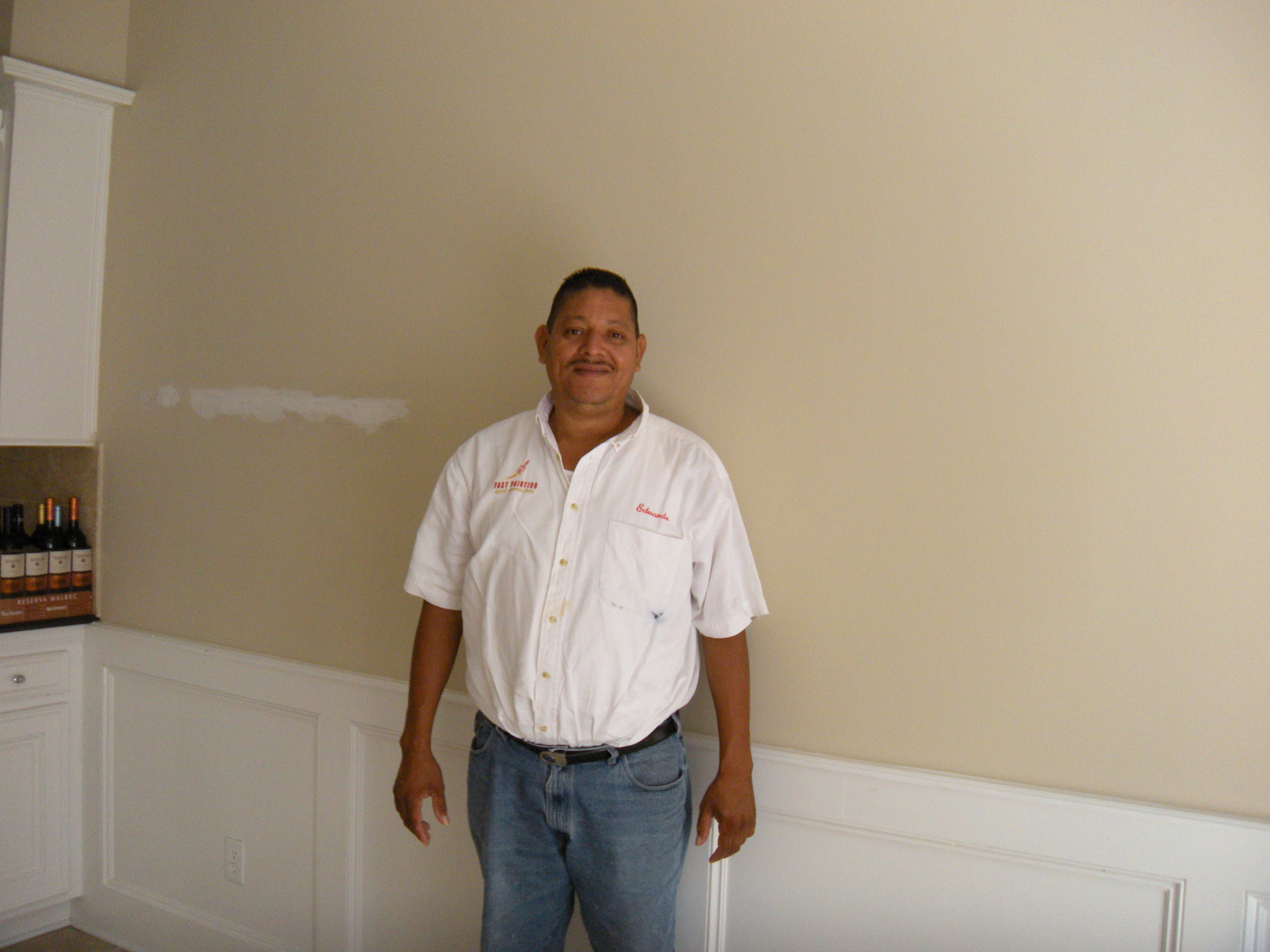 Eduardo, our contractor. His company is called Fast Paint, but he does more than paint. Works hard and does a good job. Honest and polite crew. The wine on the counter is mine.