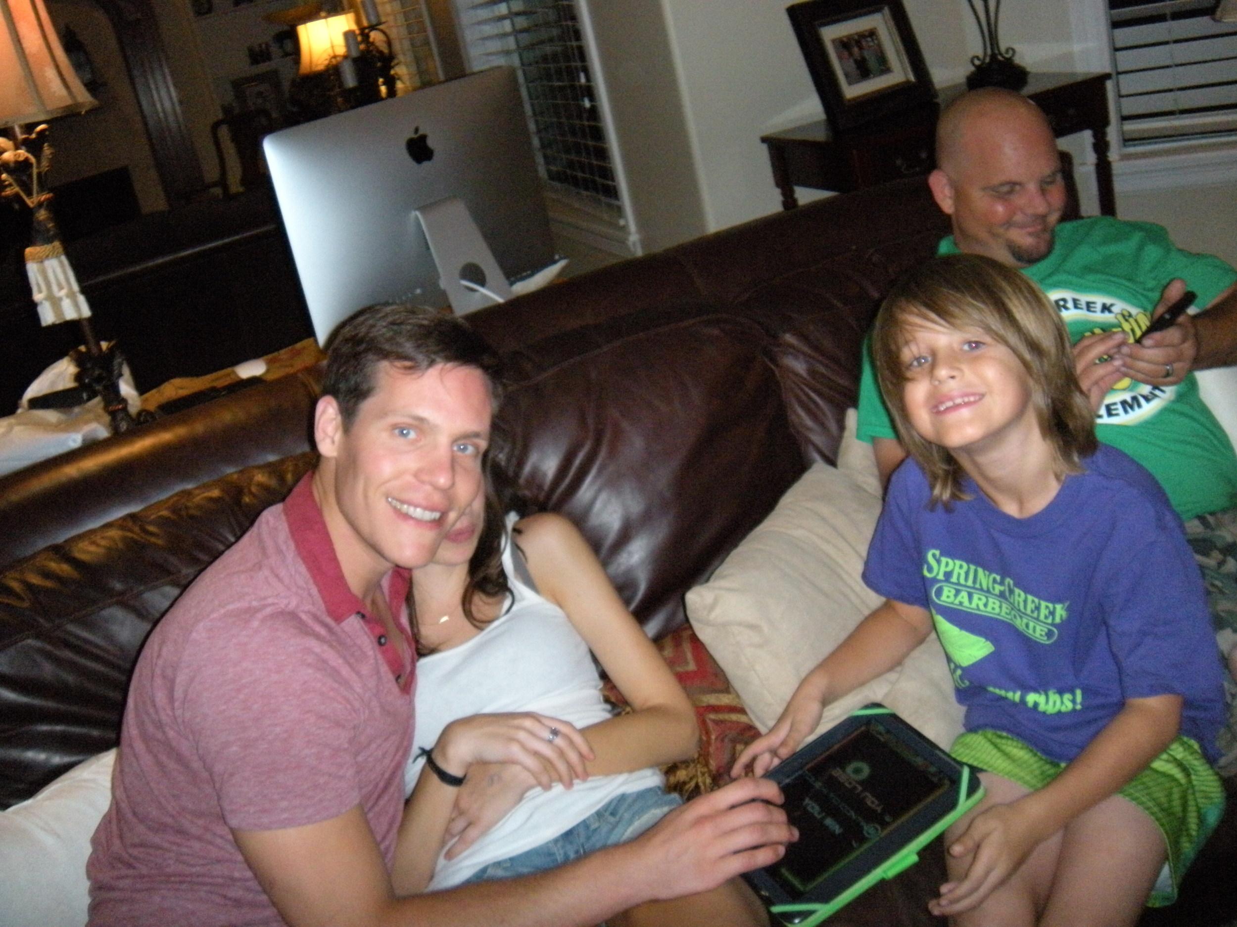 Curtis playing with Kedan. Anna's behind Curtis. That's Greg, Keri's husband, behind Kedan.