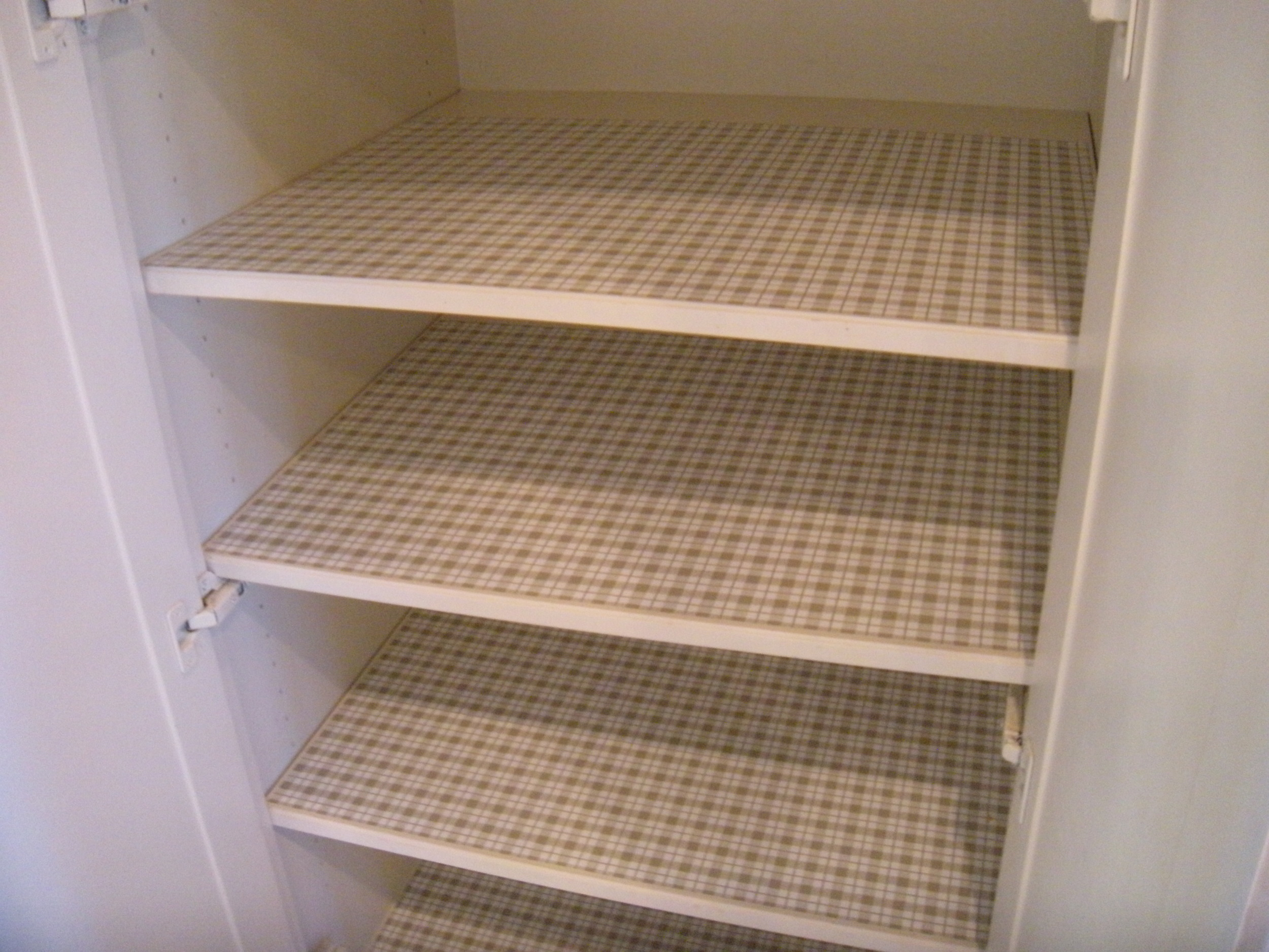 Shelf papermakes the shelves look clean and ready to receive stuff.