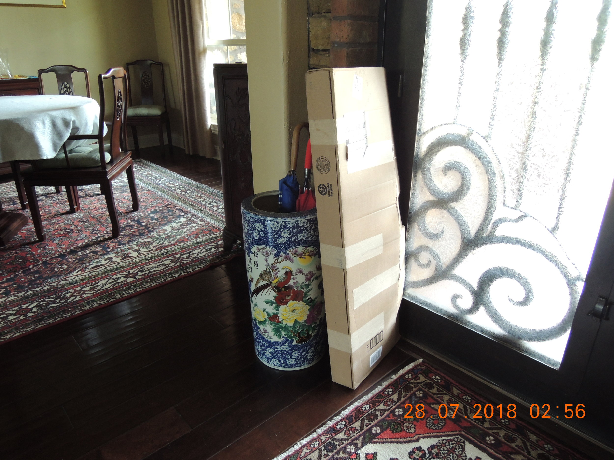 The package by the front door. It turned out to be a bird feeder stand and it looks a lot better than the last one.