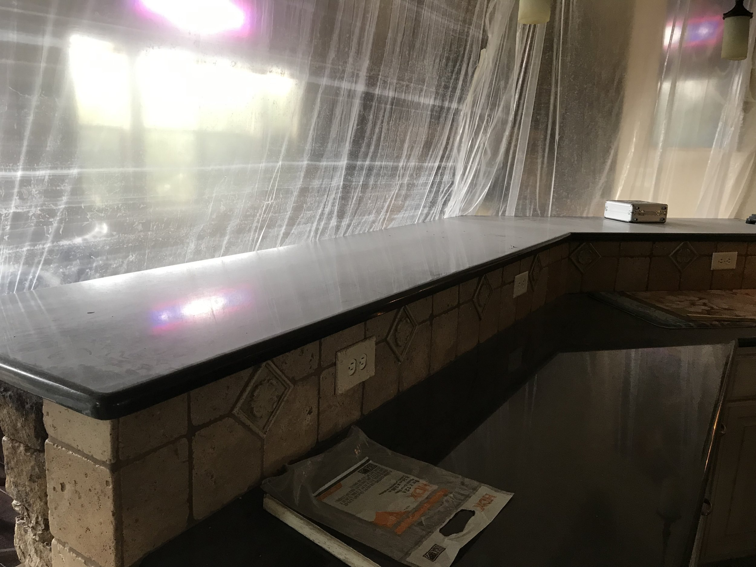 The bar draped in plastic. Can you tell how dusty it is? That much dust is everywhere.