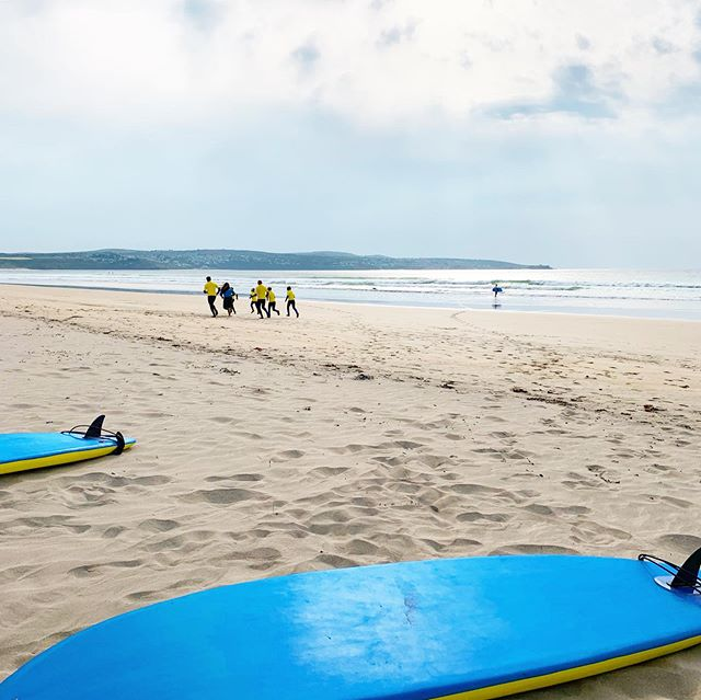 Warm & Stormy Elena Warming up the Group. . . #surf #surfinglessons #learntosurf #thissummer #hayle #beach #stivesbay #eastquayhayle #booking #office #paddleboarding #centre #visitcornwall #lovecornwall #cornwall #adventure