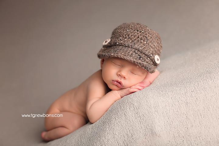 newborn with hat