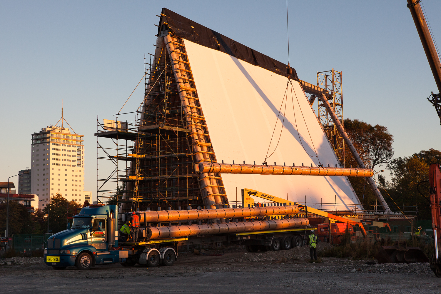 The 20-foot long cardboard tubes arrive by truck