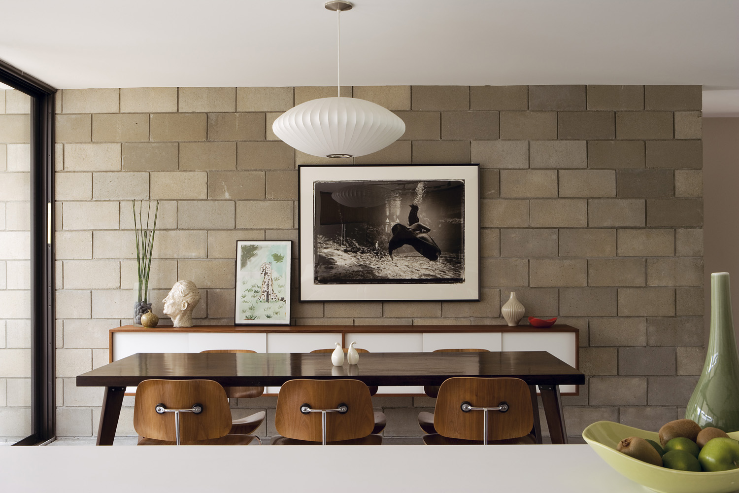Fifty shades of grey: The bare brick feature walls throughout the house bring the mid-century look bang up to date