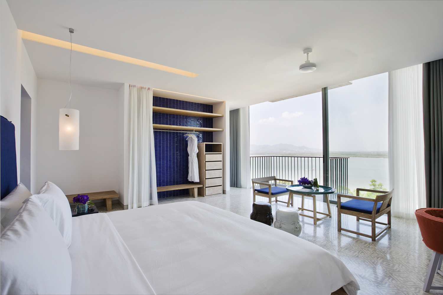 Bedrooms come in a choice of cobalt blue or turquoise schemes, teamed with soothing white, wood and tactile tiles. Floor-to-ceiling windows and balconies offer vistas of Phang Nga Bay
