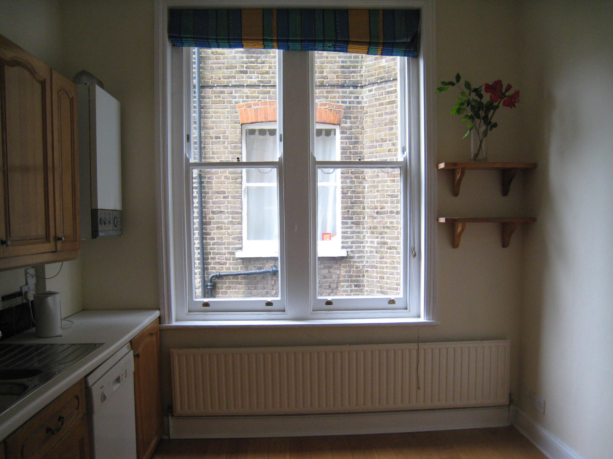 36 Elgin - Kitchen side window before.JPG