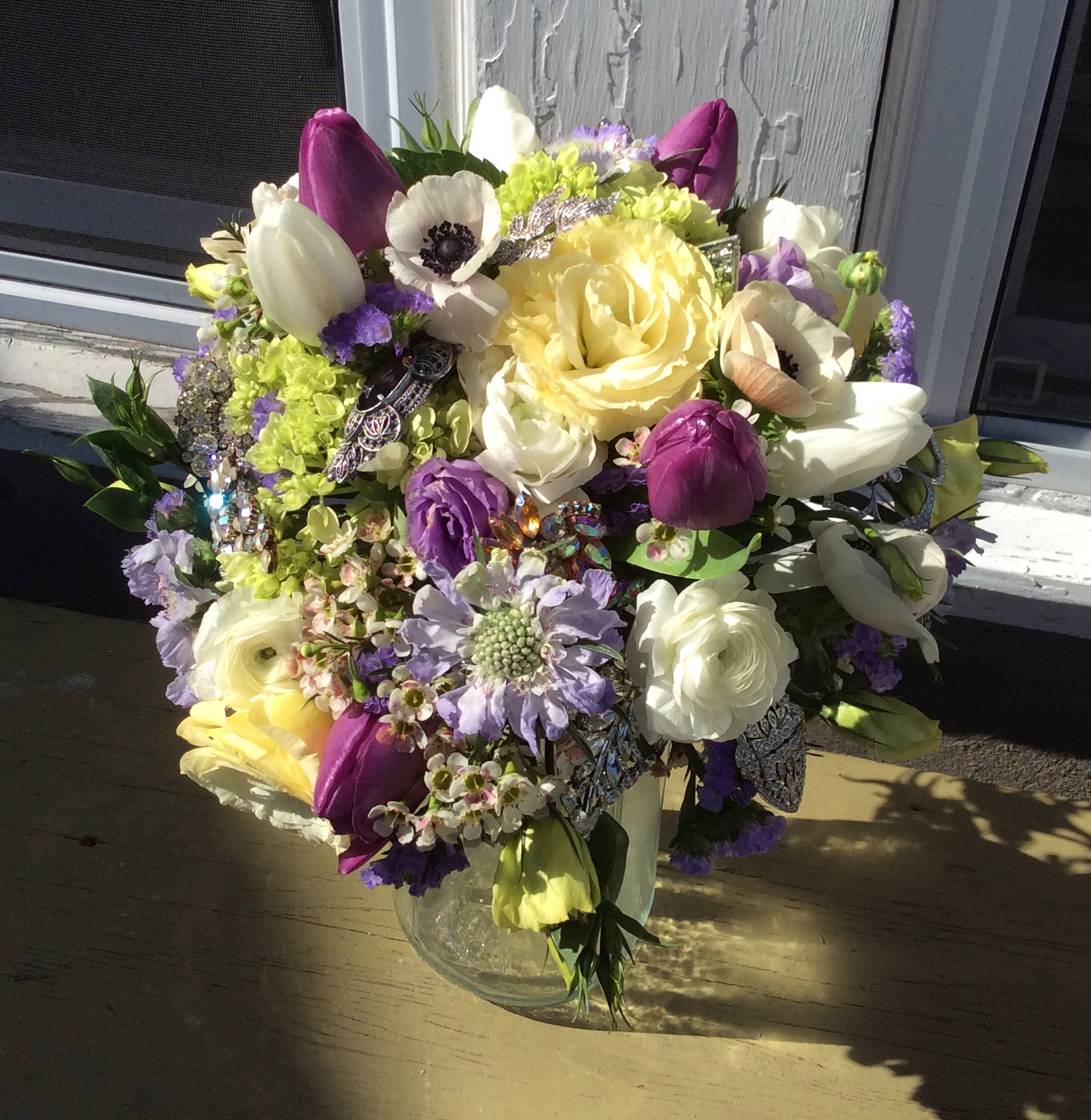 There were 10 rhinestone brooches in this bouquet.  Their sparkle enhanced the lisianthus, scabiosa, ranunculus, anemones, hydrangea, and tulips that made this bouquet and ode to spring..