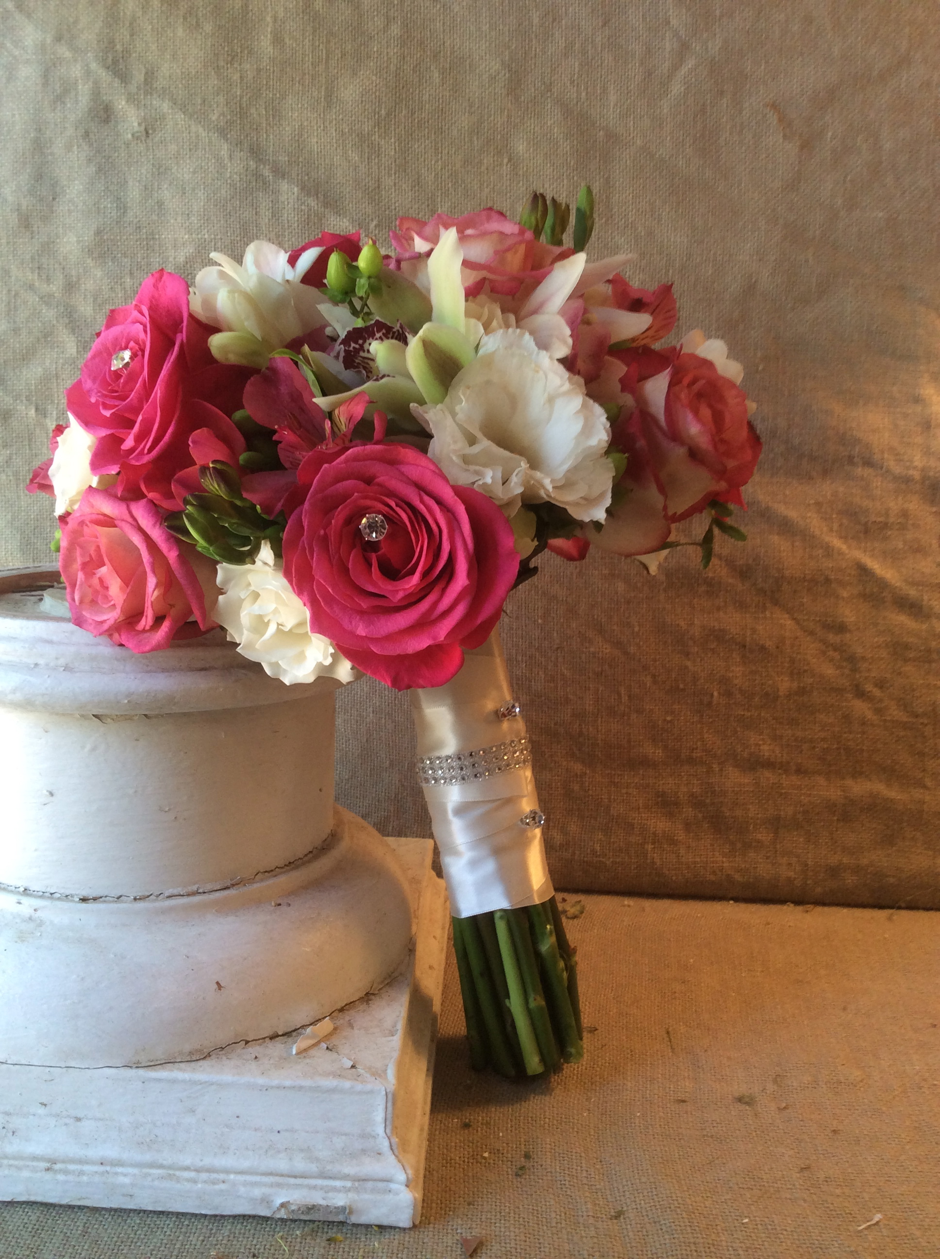 Roses, orchids and freesia get a little glam with the addition of rhinestones and a bejeweled wrap.