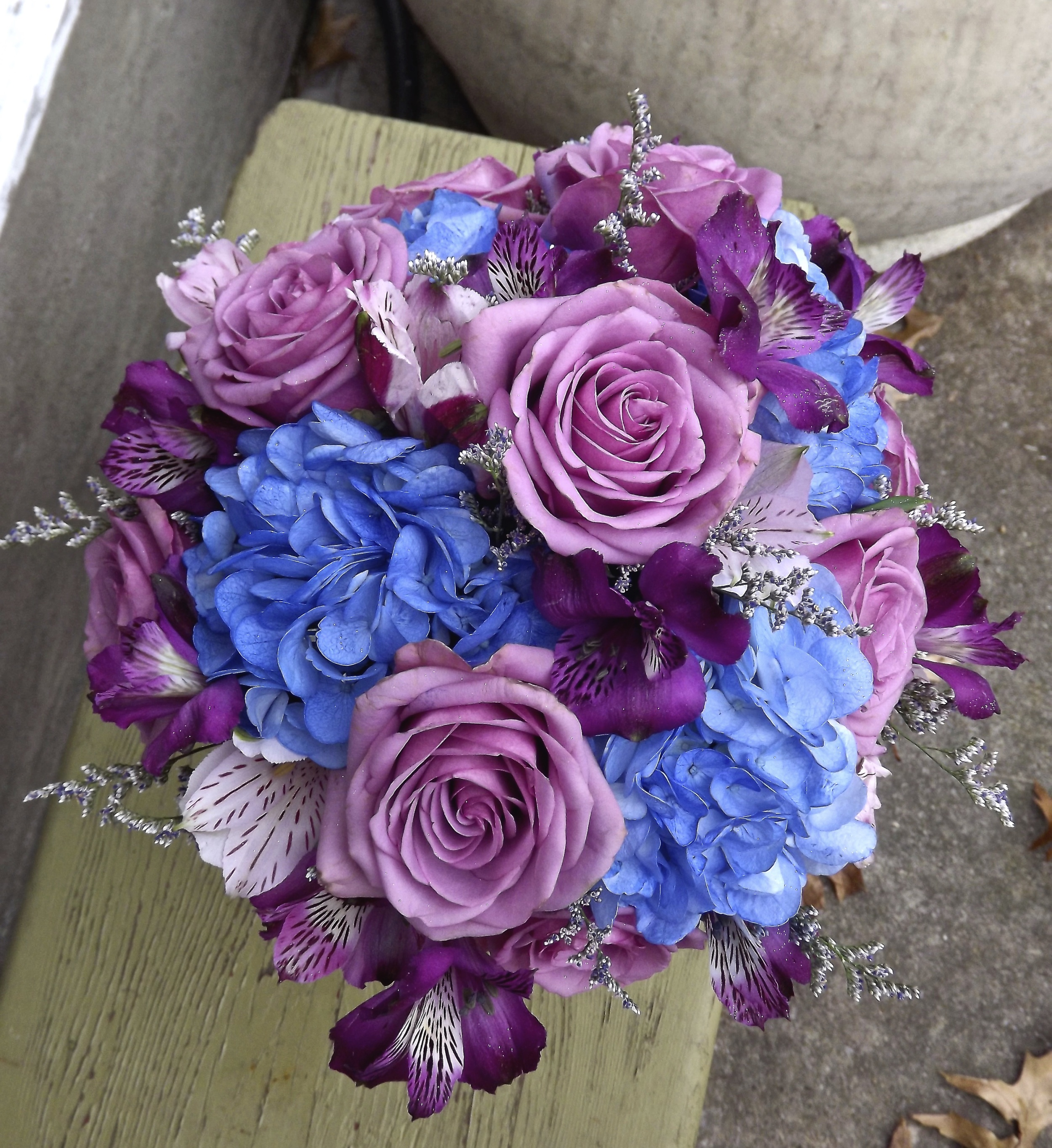 Blue hydrangea and purple roses and alstroemeria