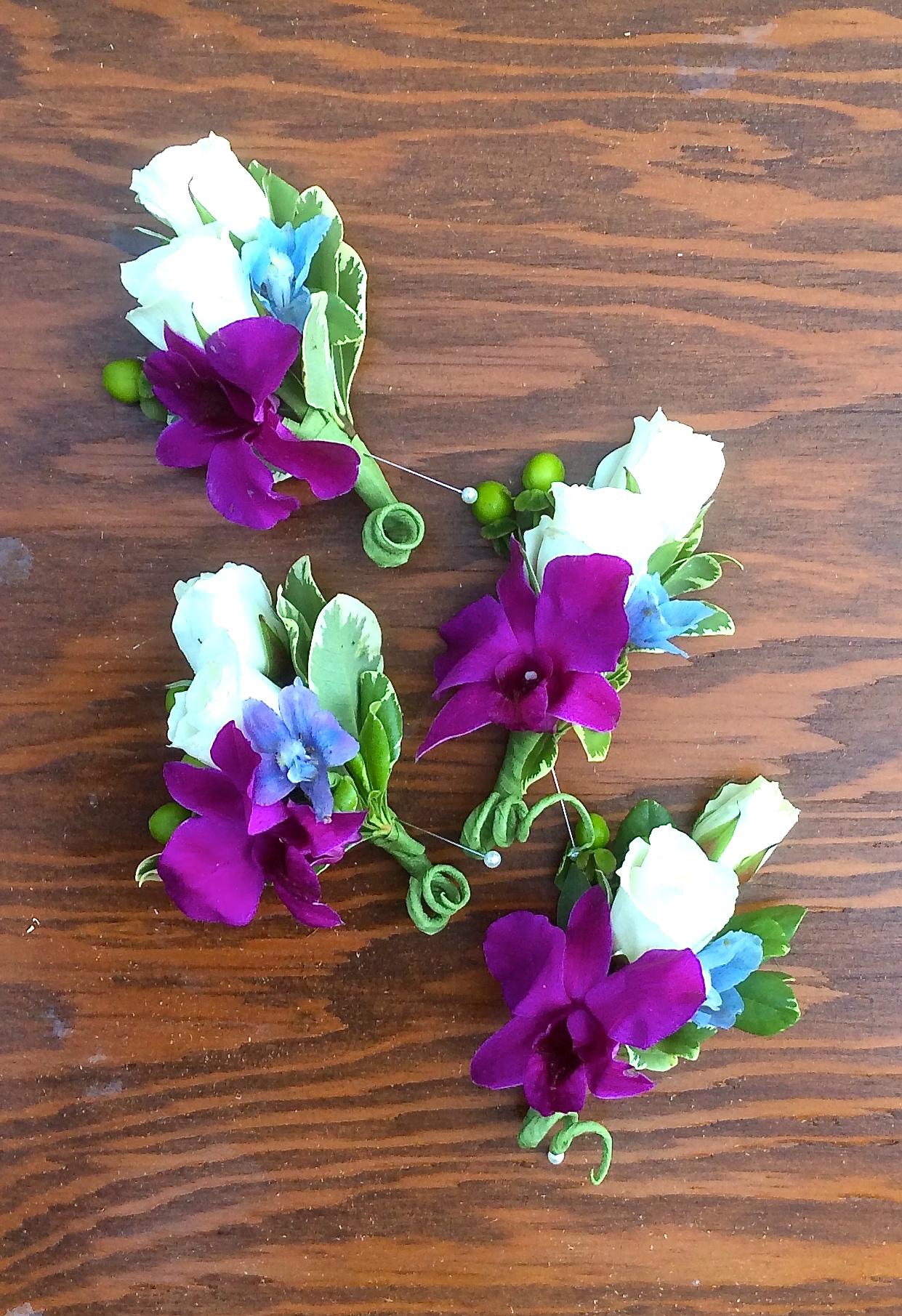 Spray roses, dendrobium orchids, and delphinium