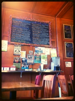 Sweet little lit up  menu on the wall! Three minutes later the place was packed. It's good to sit and eat pizza/salad lunch. A small joy.