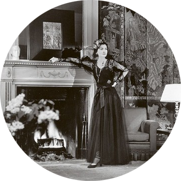 1937 - Gabrielle Chanel in her suite at the Ritz Hotel in Paris. Published in Harpers Bazaar in 1937 it was chosen for the No 5 advertising campaign.