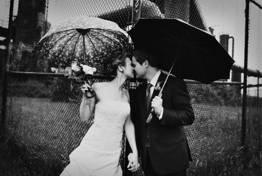 This gorgeous shot proves that rain doesn't have to ruin your big day { Via }