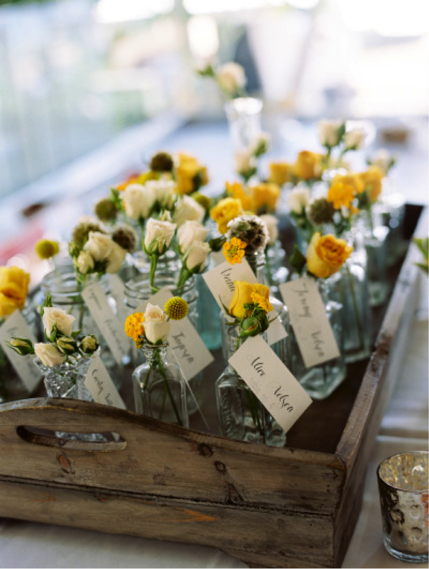 Consider these sweet little escort cards if you are planning an outdoor, rustic wedding { Via }