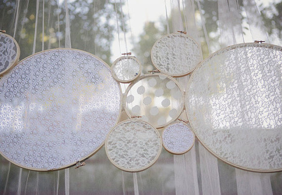 {Via}  These handmade lace circles are great for any ceremony space, bridal shower, baby shower, or even a girl's birthday party. Change up the colors to put a more modern twist on the decor!