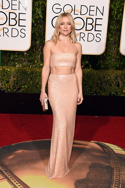 Kate Hudson is looking chic and sexy in this two-piece Michael Kors Collection dress. Needless to say, Kate is absolutely killing this look! The full sequins make the dress sparkle and catch each camera flash... well played Kate!
