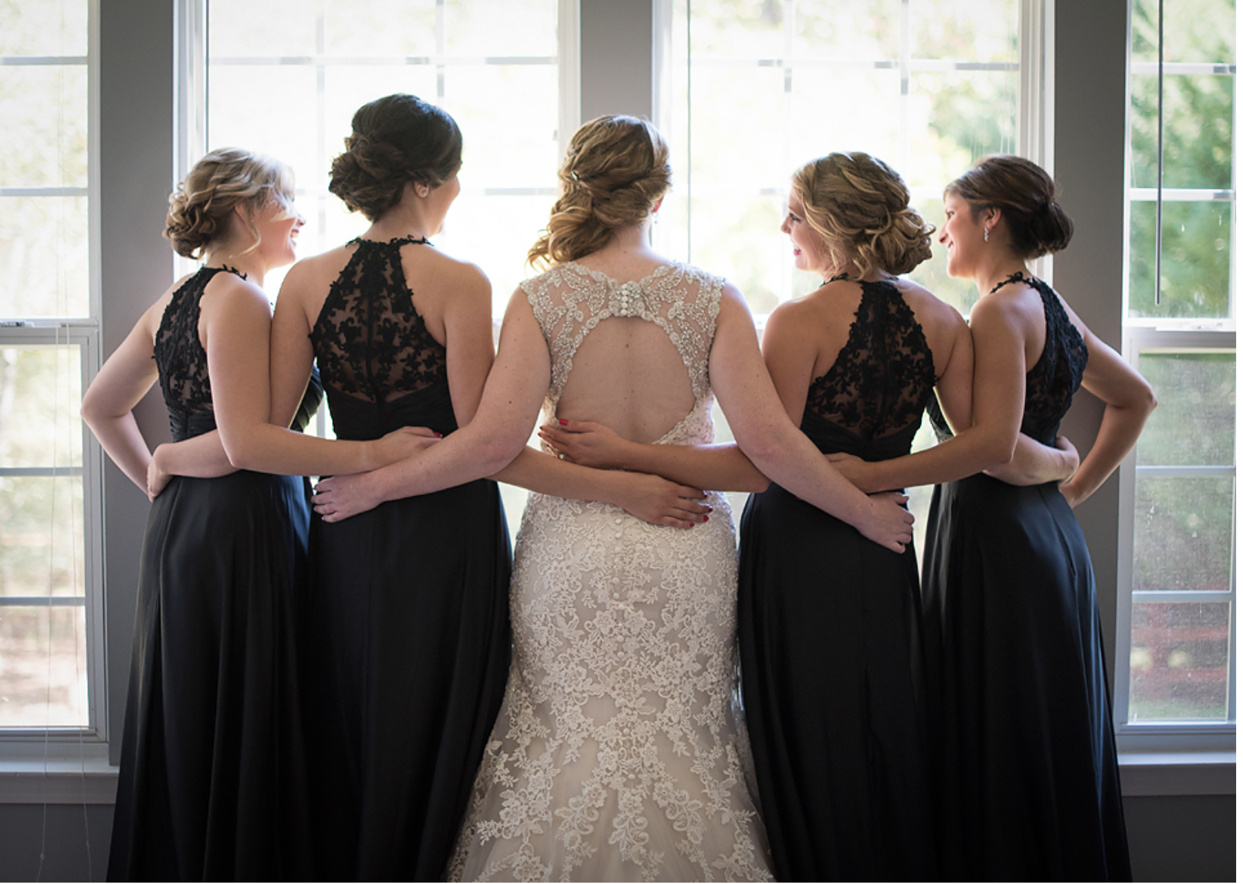 Choose a simple color and cut and focus on the back! These beautiful dresses have a zip-up lacy back that the guests can see when your bridesmaids are standing up at the alter and walking down the aisle.