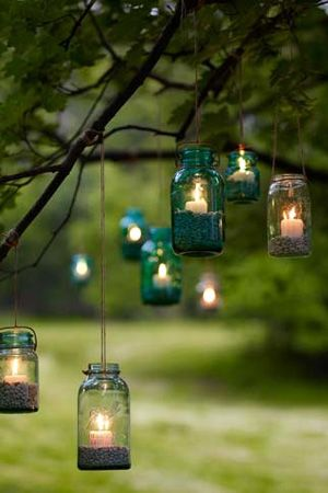 These lanterns are a cute touch for decor at your wedding or reception! The emerald colored glass is a great addition for your March color scheme