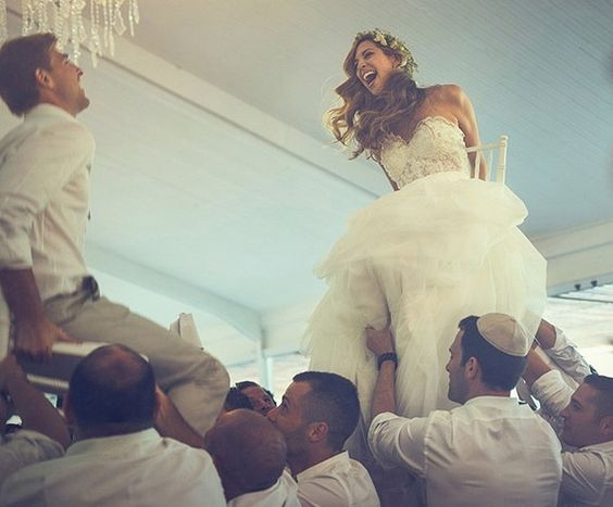 Mazel Tov! No Jewish wedding would be complete without the dancing of the Hora. At the ceremony the bride and groom are both lifted in their chairs and are danced around the room by their friends, family, and loved ones.