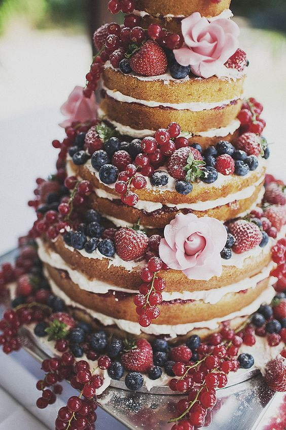 """Naked Cakes"" have been a huge trend this past year for wedding cakes. Adding fruit will make your cake have that pop of color to match your theme!"