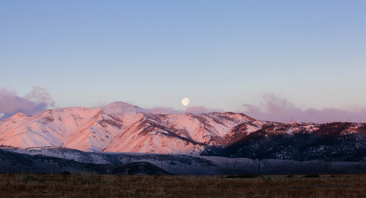 Moonset and sunrise on the Eastern Sierras near Bridgeport, Calif. off of Highway 395.