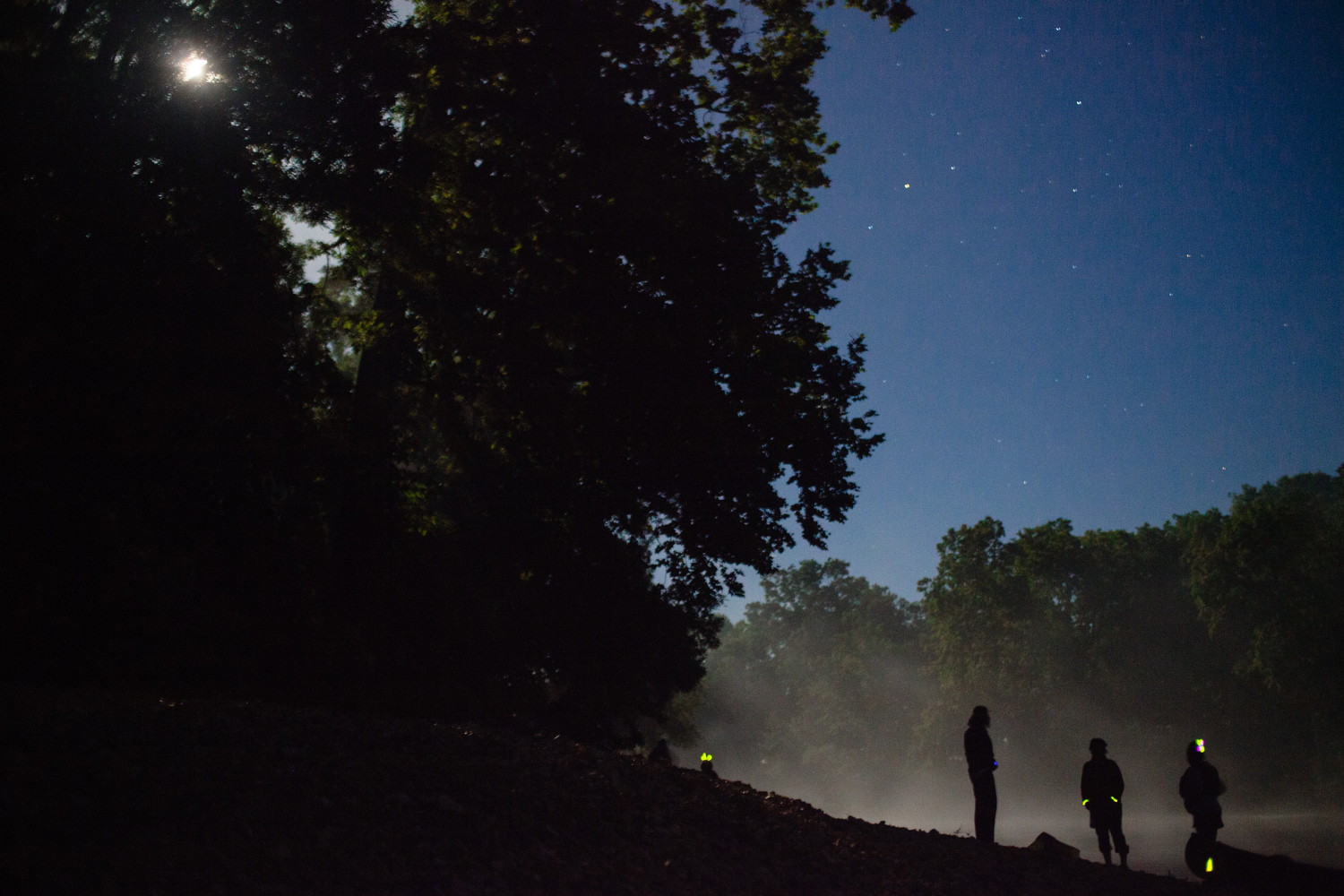Stopping at a gravel bar during a night float of the James River.