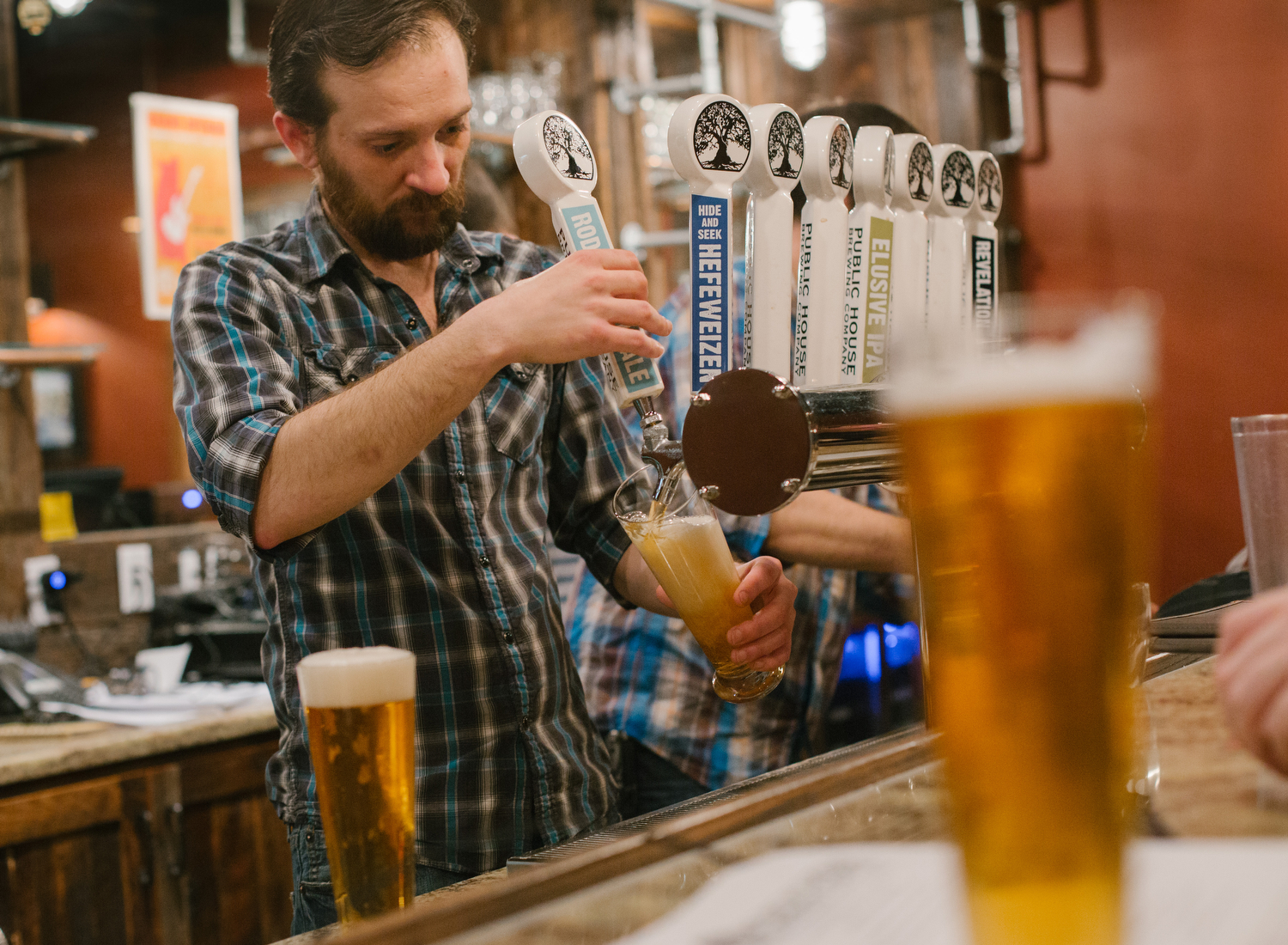 Bartenders pouring craft beer.