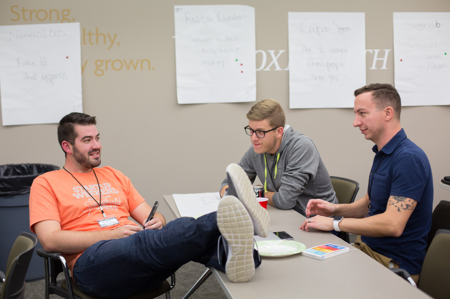 Chris Allen, left, a Startup Weekend Springfield organizer, talks with Tim Cook and Dan Seawel, right, during the competition at the eFactory in Springfield, Mo. on Nov. 20, 2015. Photos by Brad Zweerink