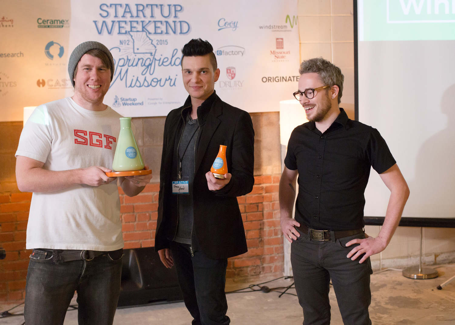 Myke Bates, Jason Arend and Brandon Cash, left to right, won first place in the Startup Weekend Springfield competition with their workplace communication software, Eagle Speak, at the eFactory in Springfield, Mo. on Nov. 20, 2015. The trio's startup, Eagle Speak, won the event. Photos by Brad Zweerink