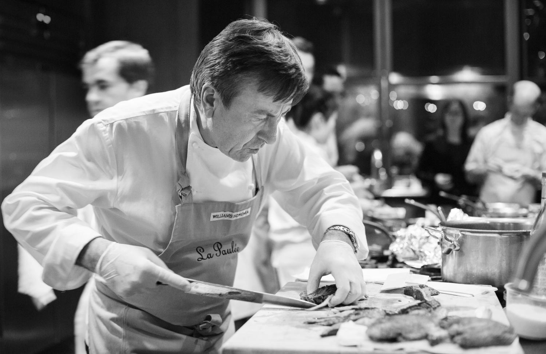Chef Daniel Boulud slices duck.
