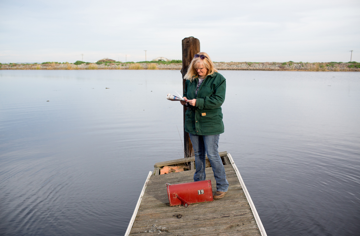 Karen Cunningham, a rancher and land owner on Bradford Island in the Sacramento–San Joaquin River Delta, checks her mailbox.