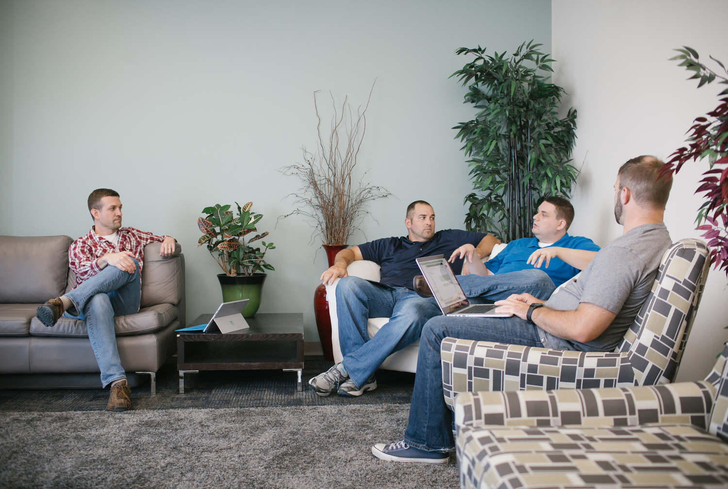 Brad Hinman, Michael Cory, Andrew Jordan, and Greg Sutton, left to right, talk during a weekly project meeting at PILR TECH's office in Joplin, Mo. on Sept. 27, 2016. Photo by Brad Zweerink