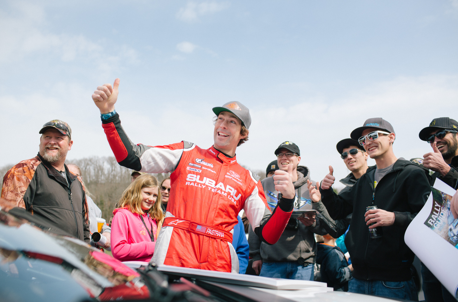 Subaru Rally Team USA driver Travis Pastrana, center, poses for a picture with fans before the start of the Rally in the 100 Acre Wood race in Steelville, Mo.