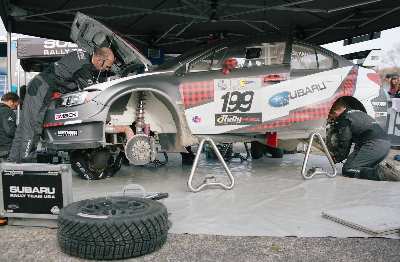 Subaru Rally Team USA crew members work on Travis Pastrana's 2016 Subaru WRX STI.