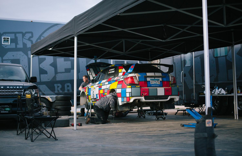 Crews work on Nick Roberts' 2013 Subaru Impreza WRX STi.