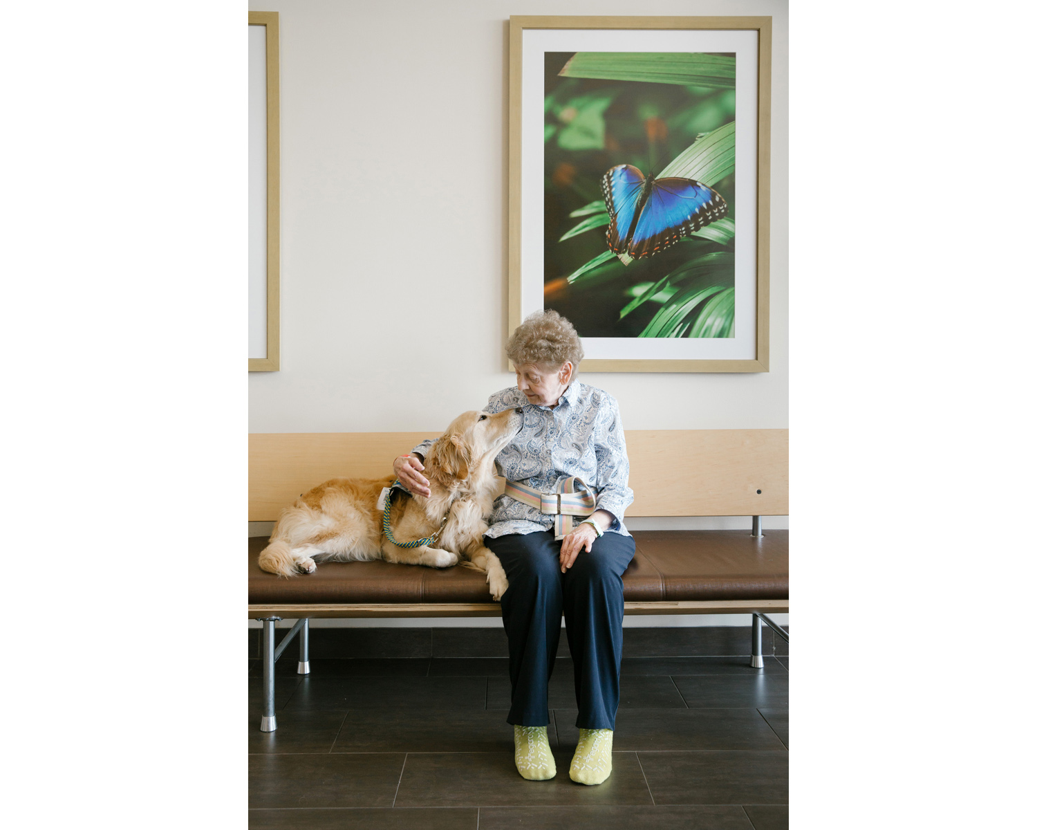 Jacqueline Ramage takes a break with Pria, a therapy dog, during a walk at the Mercy Rehabilitation Hospital in Springfield, Mo. on June 1, 2017. Photo by Brad Zweerink.