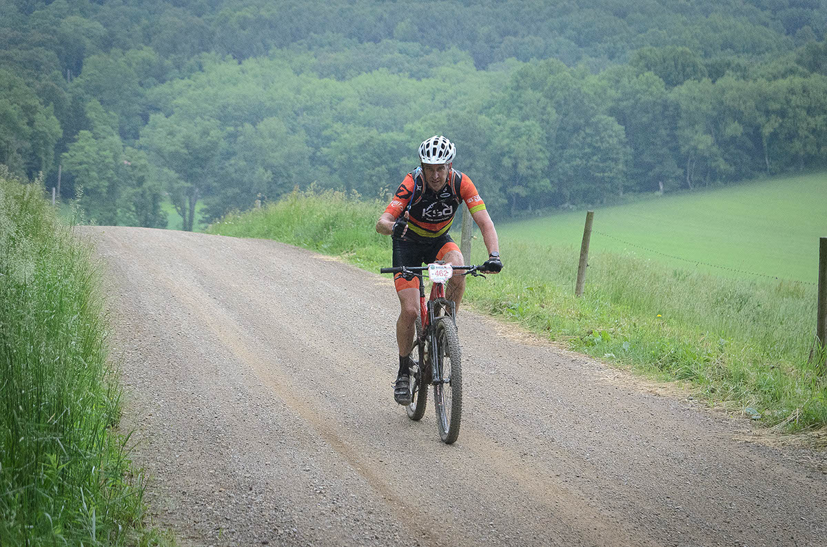 Tom Weaver of Knobby Side Down on the happy side of the Griffin Road Climb. Photo Credit: Butch Phillips