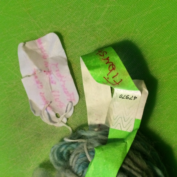 A paper tag and a tyvek band side by side after a hot soak and a snap.