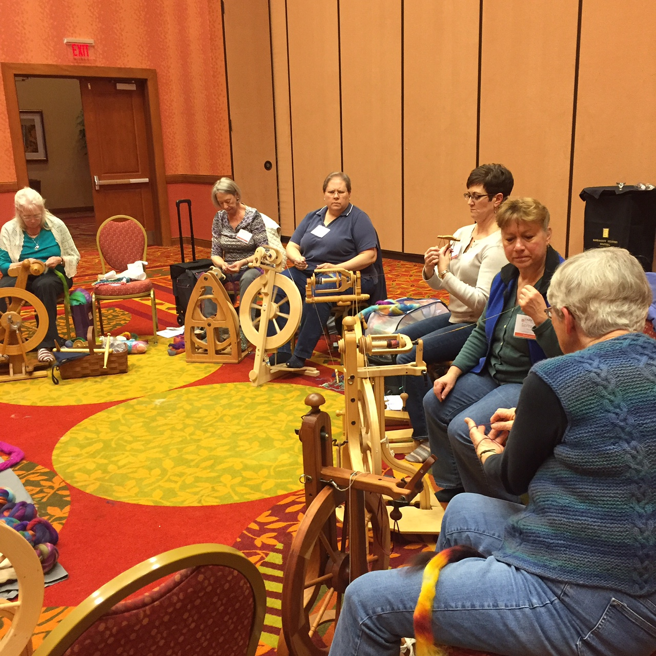 Maggie Casey, lower right, demonstrating Andean plying.