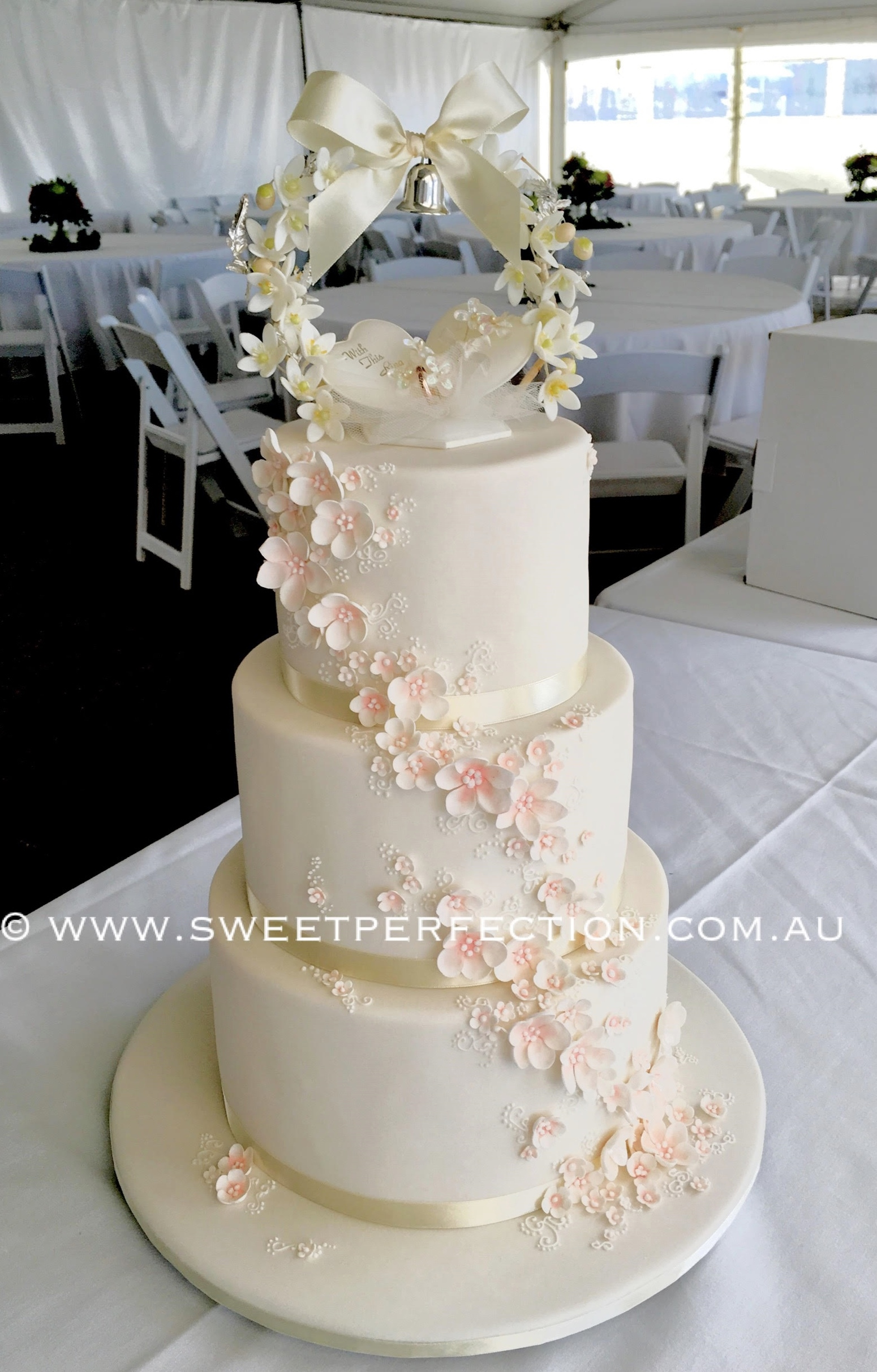 Vintage topper and blossoms cake.jpg