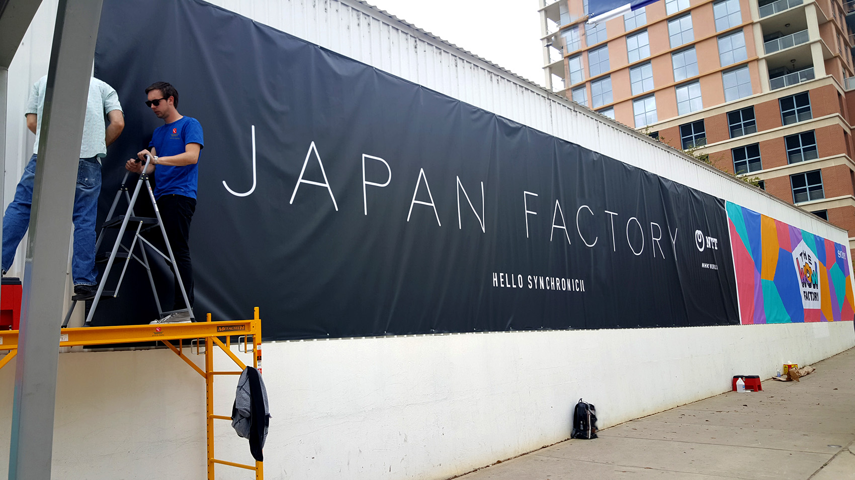 We print and install large banners.