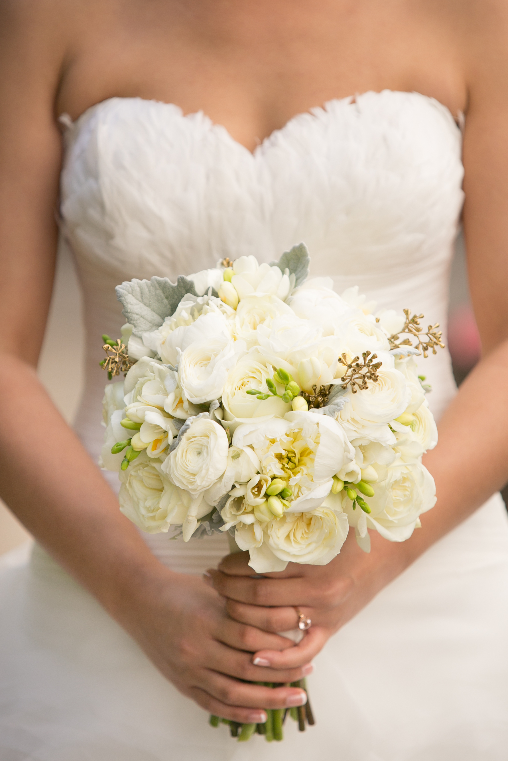 Jenny carried a natural design hand tied bouquet with mostly white flowers accented with dusty green and gold. Flowers included: peonies, rose, ranunculus, freesia, tulips.