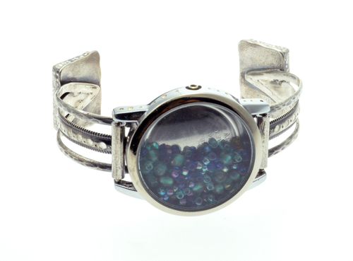 """Bracelet made in the """"Radical Jewelry Makeover"""" project: Made of a watch, silver bracelet and turquoise earrings."""